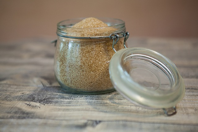 A small jar full of brown sugar.